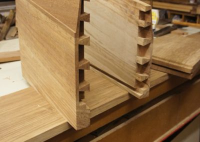 Hand cut Dovetail joints detailed on the lower tapered bookcase ends.  SASPOONER