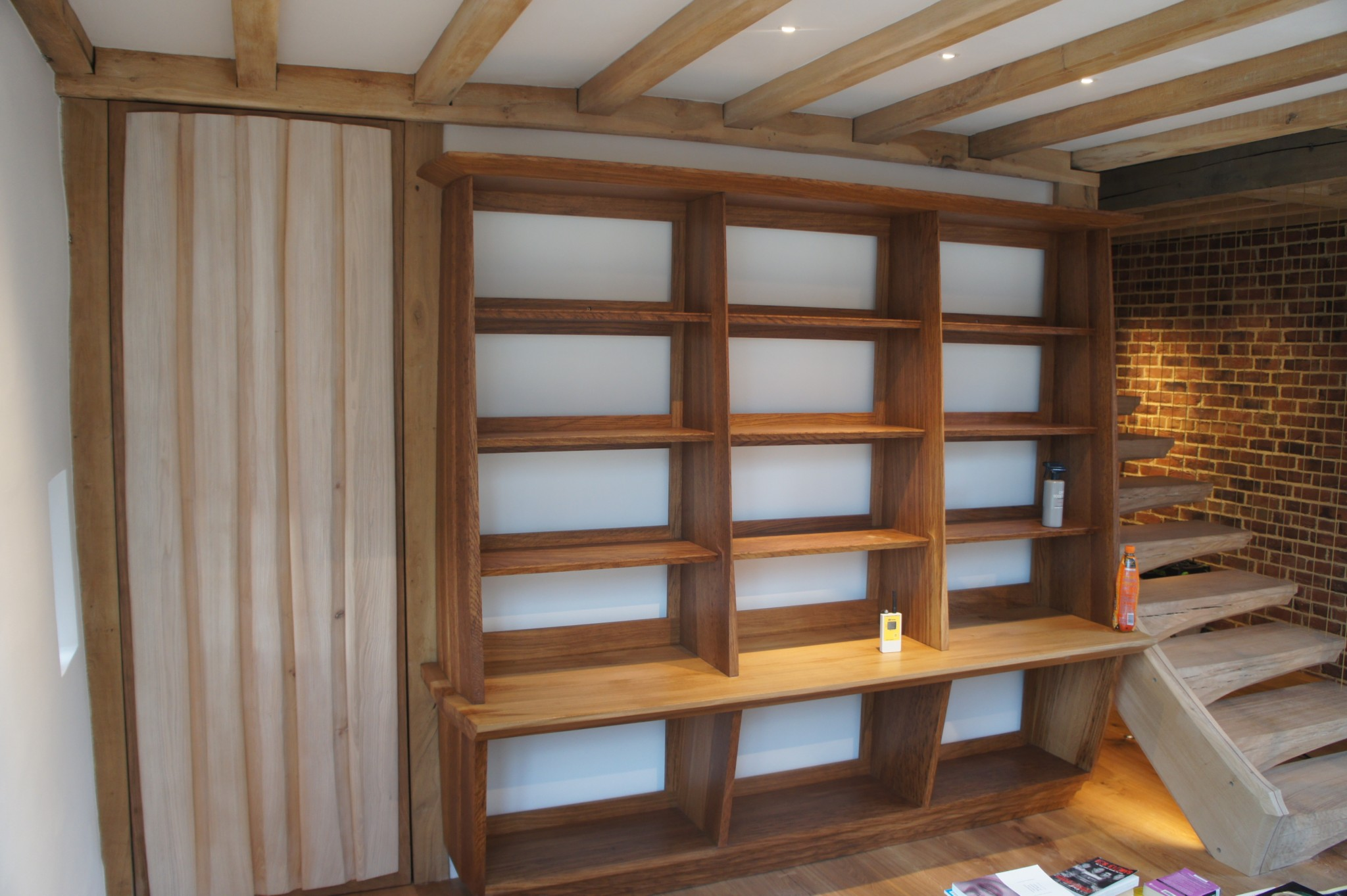 The Bookcase installed in its original position, now after lowering the floor height and remodelling the room by S A Spooner