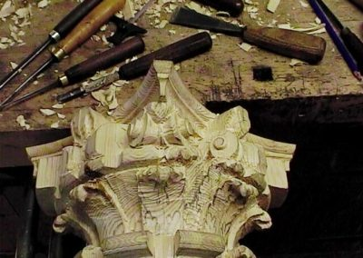Carving a column capital in softwood .SASPOONER