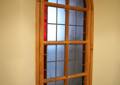 Gothic window in Oak made as borrowed light and fire escape. SA Spooner
