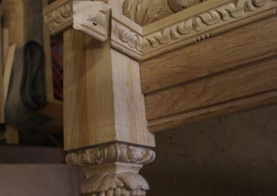 The bottom of the end newel post and carved finial final fitting in the workshop before site delivery. SASPOONER