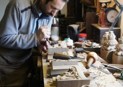 Stephen Spooner carving at the bench,working on the Queen Anne carved staircase brackets.  SASPOONER